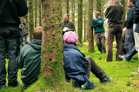 Forest students and others listen to Hungarian ProSilva forester Peiter, in a forest near Lismore, Co. Waterford. Photo: Cathy Fitzgerald