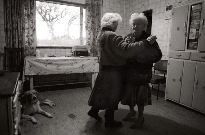 Dancing in the Kitchen (Bridie Callinan and Kathleen O'Loughlin, Co. Clare). Photograph by Christy Mc Namara© 1993-94